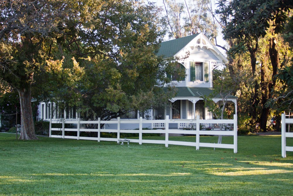 Victorian Farmhouse With White Picket Fence