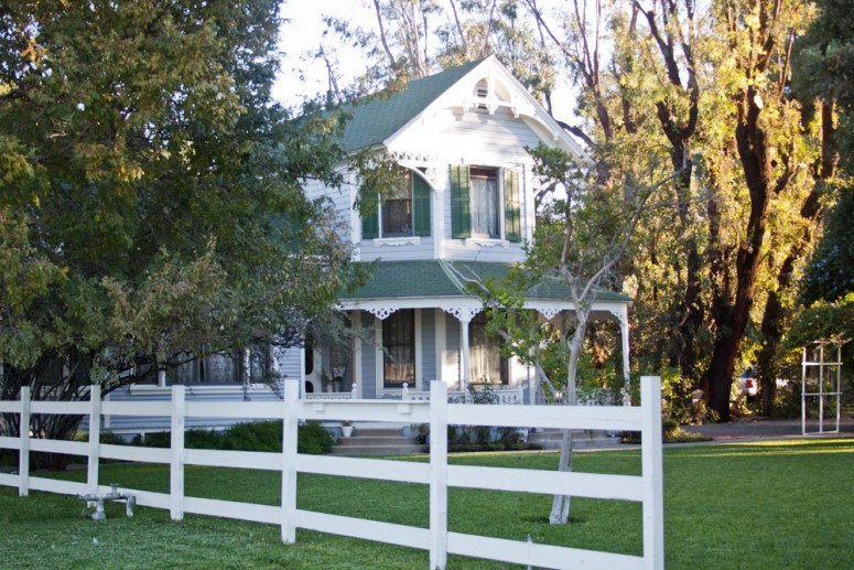 Victorian Home with Picket Fence and Green Lawn at Paddison Farm