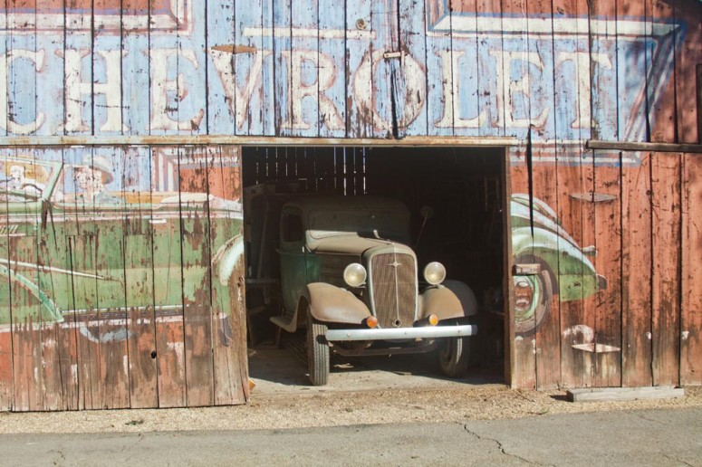 Vintage Chevy Truck peeking out of a Large Barn at Paddison Farm